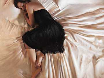 Woman in Bed - Hyper-realistic painting by Tina Spratt