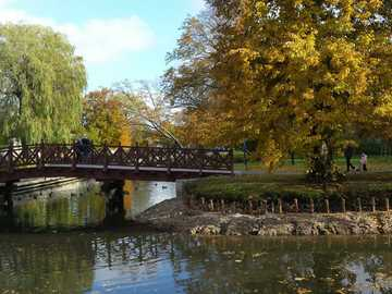 Wejherowo Park - Park in Wejherowo. Bridge on the lower channel and trees in autumn garment