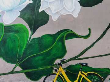 Visit behance.net/cullandnguyen for more of our work. - yellow bike parked beside white flowers graffiti during daytime. Little India, Singapore