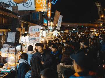 Among The Unknown - group of people infront of store. Shilin Night Market, Taiwan