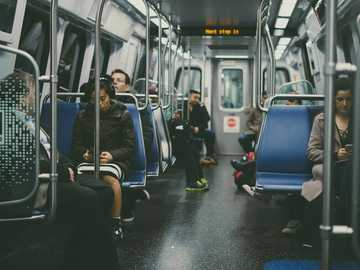 DC Subway - group of person sitting on blue chairs. Washington, United States