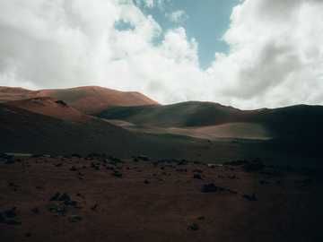 mountain ranges - This photo was taken on a trip to Lanzarote, Spain, a land carved over the Atlantic on fire and lava