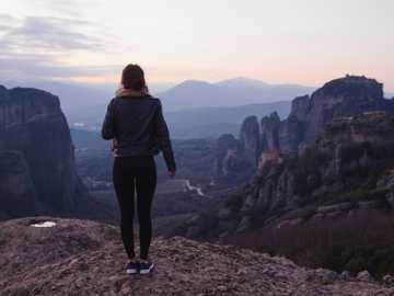 woman standing outdoor - International Women's Day. Meteora, Greece