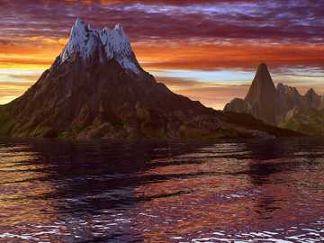 sunset - mountainous island in the setting sun