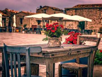 Tavern - - flowers - old table and chairs