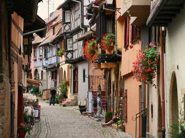 Old-style street - The town of Eguisheim in Alsace