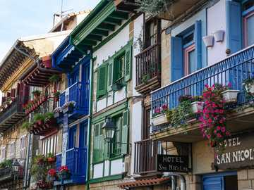 Balconies in flowers - colorful houses - facades - colorful flowers