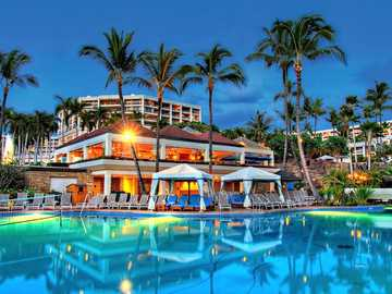 Luxury Hotel And Swimming Pool. Hawaii - Illuminated Hotel With A Pool. Hawaii