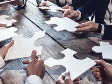 Puzzle - Équipe de travail formant un puzzle