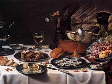 """Pieter Claesz  -""""Natura morta""""1627 - una natura morta con primi piani impreziositi dai riflessi argentati dei metalli.Tipologia detta &qu"""