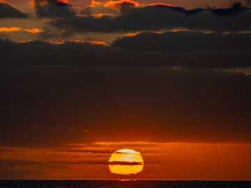 Sunset on ferry from Kangaroo Island - body of water under cloudy sky during sunset. Kangaroo Island, Carrarang, Australia