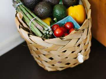 Healthy Grocery Shopping - bunch of assorted produce in brown wicker basket.