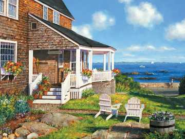 On the seashore. - The house is built on the seashore.