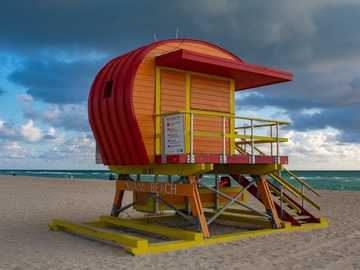 Miami Beach - orange and yellow wooden Miami beach house under blue and white sky during daytime. Miami Beach, Flo