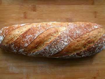 bread on brown wooden table - Sourdough bread loaf baking.