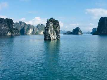 On the boat in Lan Ha Bay, Vietnam. - blue sea near gray rock formation under blue sky during daytime. Lan Ha Bay, Cát Hải, Hai Phong,