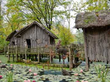 houses on stilts - wooden houses on stilts standing in water