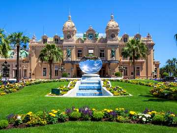 Monte-Carlo Casino. Monaco - Casino, fountain and flowers. Monaco
