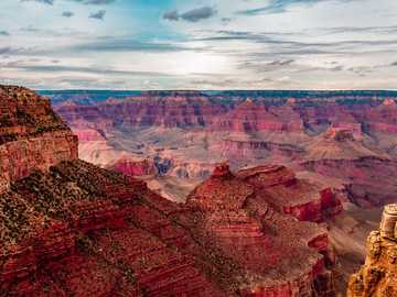 closeup photography of brown mountain - Stunning view of Grand Canyon. Its a must visit place and you are sure to get goosebumps when you se