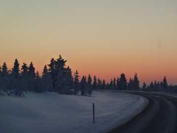 lappish twilight - setting sun on the road between Ivalo and Saariselkä (Finland)