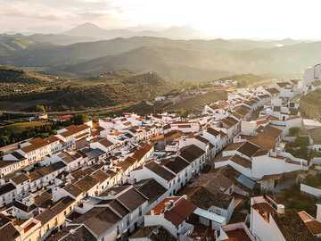"""high-angle photography of rural area - At the tip of the """"White towns route"""", the city of Olvera is in the province of Cadiz. The White"""
