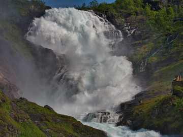 Kjosfossen Waterfall - green trees on mountain near water falls during daytime. Kjosfossen, Myrdal, Norway