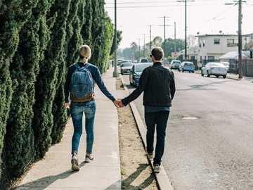 Glendale couple - man and woman walking on pathway during daytime. Glendale, United States