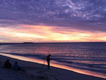 Gone #fishing. - silhouette of man and woman walking on beach during sunset. Jurien Bay WA, Australia