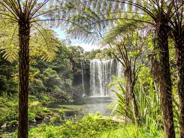 Beauty of nature - View of a picturesque waterfall surrounded by greenery