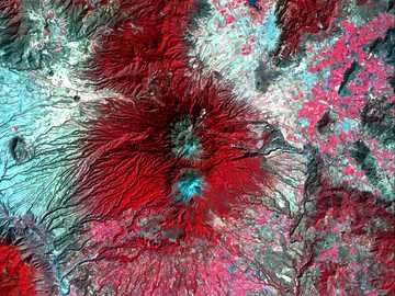 red and gray abstract illustration - Snow-capped Colima Volcano, the most active volcano in Mexico, rises abruptly from the surrounding l