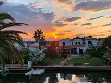 Evening mood over Ampuriabrava - House on the canal in the evening