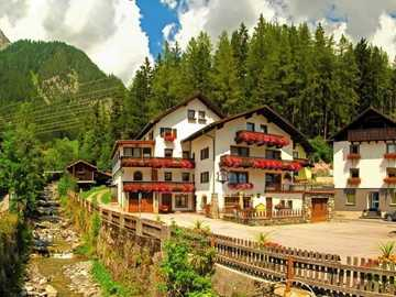 A town in the mountains - Cottages On A River In The Mountains.