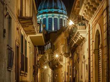 Evening in Ragusa - Sicily, Italy - Game of lights on the way - church tower in the background