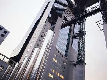 Japan Architecture - glass building under white sky. Osaka, Japan