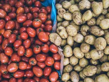 Tomato & Potato - photography of orange tomatoes and brown potatoes. Hanoi, Vietnam