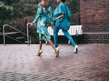 two women in teal romper pants - It's was very cold and miserable and I was wondering what the hell I was doing out at the barbican