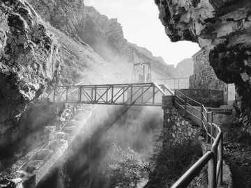 Ruta del Cares - grayscale photo of bridge over river. Caín de Valdeón, España