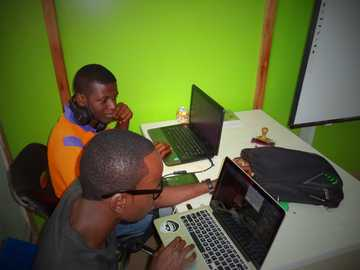 Nhub Nigeria - two men using laptop computes. Abuja, Nigeria