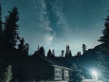 white and brown house near trees under starry night - Milkyway over Elizabeth Parker Hut, Lake O Hara in Yoho National Park. . Elizabeth Parker Hut, Lake