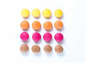 Macarons - assorted-colored cupcakes clip art.