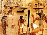 La prova di Osiride - La prova di Osiride. Nella Duat, lo spirito del defunto era guidato dal dio Anubi davanti alla corte