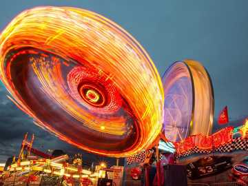 amusement park - carousels and a ferris wheel - attractions