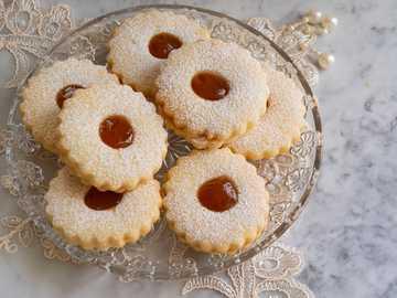 algerian sablé - three brown cupcakes on clear glass plate. Alger, Algeria
