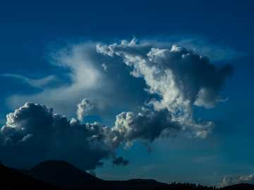 white clouds and blue sky during daytime - Anatomy of a dying stormcell. A stormcell disolves over the San Francisco Peaks.