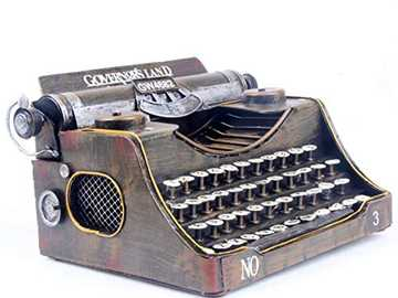 TYPEWRITER - It is iron, it has keys, a roller and its color is bronze