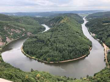 aerial photography of river during daytime - Natural attraction saarschleife in Saarland, Germany. saarschleife, Germany