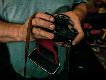 closeup photo of person holding camera - Throwback to the day I spent in Slovenia. Had the chance to meet this gentleman, also a props maker,