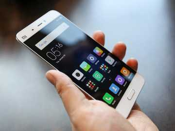 Smart Phone - A smartphone is a mobile device that combines cellular and mobile computing functions into one unit.