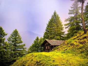 Mountain landscape - A hut - a resting place for a wanderer