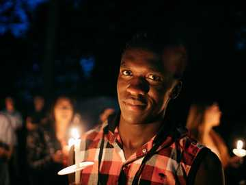 man holding candle - I am a black kid but here I get to be brown :)